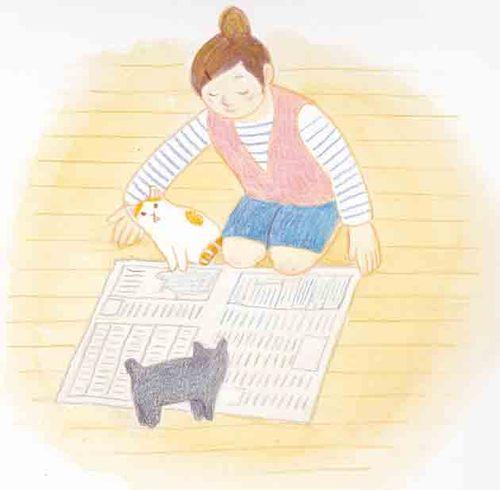 新聞紙を広げる